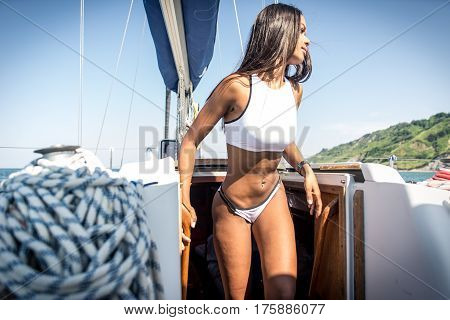 Sexy brazilian woman on her yacht. Getting out in the sun