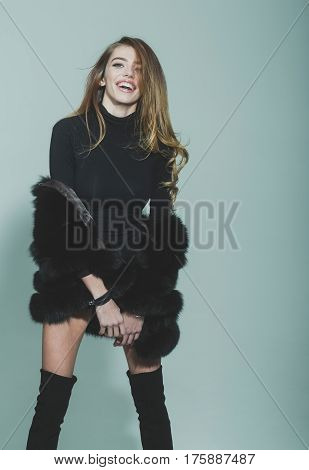 Pretty Sexy Woman With Long Hair In Fur And Jackboot