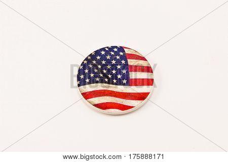 a ceramic US flag medallion (origin unknown)