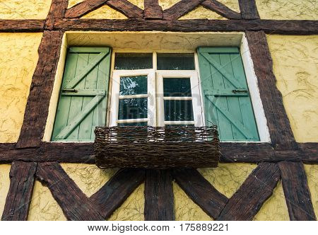 Facade of cottage house with window in vintage tone selective focus.