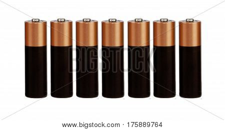 Seven batteries of the type AAA on a white background, isolated