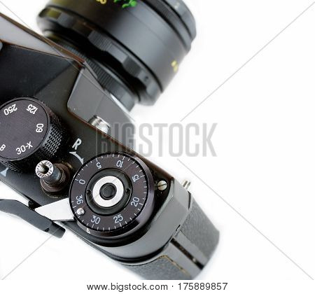 Close-up view of a classic manual SLR film camera isolated on white background