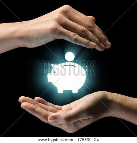Isolated image of two hands on black background. Money box icon in the center as a symbol of protection of cash savings. Concept of protection of cash savings.