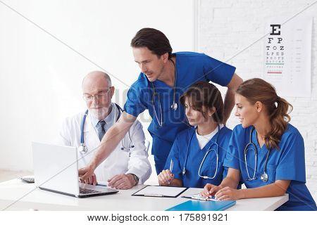 Medical Doctors Team Using Computer