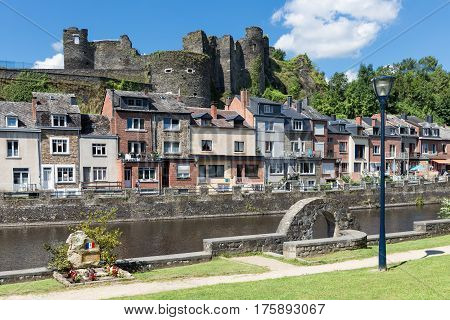 LA ROCHE-EN-ARDENNES BELGIUM - AUGUST 14 2016: River Ourthe in the historic centre of La Roche-en-Ardenne in Belgian Ardennes with medieval castle and a small WW2 memorial