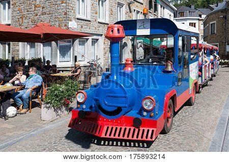 LA ROCHE-EN-ARDENNES BELGIUM - AUGUST 14 2016: People in tourist train in the historic centre of La Roche-en-Ardenne in Belgian Ardennes