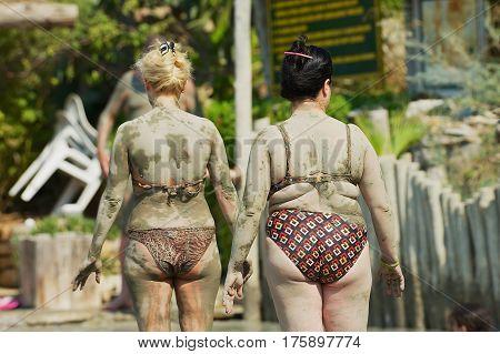 DALYAN, TURKEY - AUGUST 13, 2009: Unidentified women dry after taking mud bath in Dalyan, Turkey.