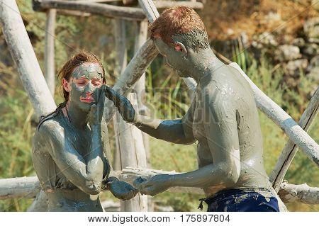 DALYAN, TURKEY - AUGUST 13, 2009: Unidentified people take mud bath in Dalyan, Turkey.