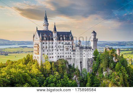 Famous Neuschwanstein Castle With Scenic Mountain Landscape At Sunset Near Füssen, Bavaria, Germany