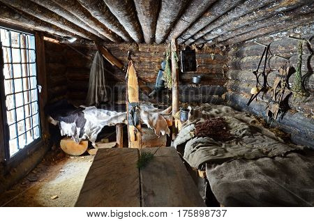 Irkutsk regionRussia-Feb18 2017: Interior of the Hunting hut in Museum of Wooden Architecture Taltsy