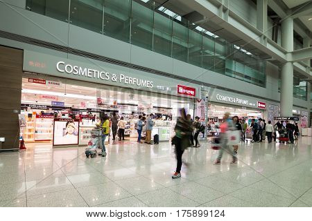 SEOUL KOREA - APRIL 29 2015: People walking in Incheon Airport Seoul; Korea