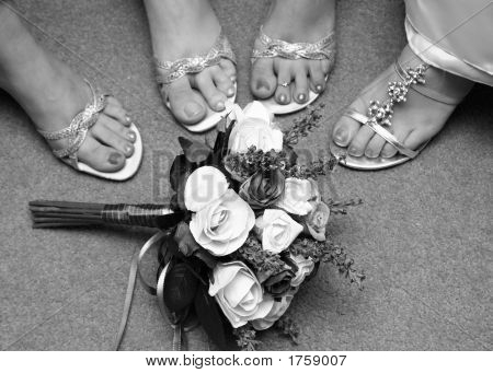 Feet And Bouquet Of Bride And Maids
