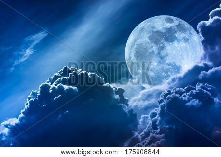 Super Moon. Nighttime Sky With Clouds And Bright Full Moon With Shiny.