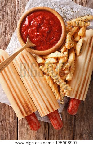Spicy French Hot Dog Rolls With French Fries And Ketchup Closeup. Vertical Top View