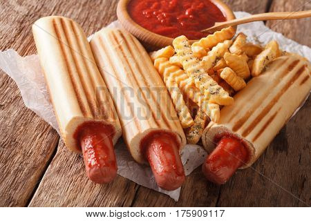 Hot Dog Rolls With French Fries And Tomato Sauce Close-up. Horizontal
