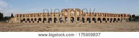 ISFAHAN, IRAN - OCTOBER 11, 2016: Khaju bridge crossing parched Zayandehrud river on October 11, 2016 in Isfahan, Iran