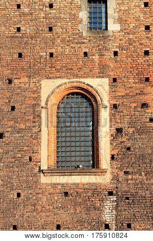 Medieval window of Sforzesco castle in Milan, Italy