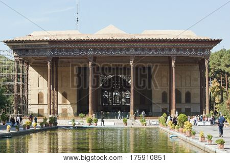 ISFAHAN, IRAN - OCTOBER 13, 2016: People visiting Chehel Sotun Palace on October 13, 2016 in Isfahan, Iran