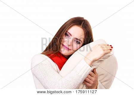 Woman sleepy tired girl holding pillow almost falling asleep. Health balance sleep deprivation concept. Female student or worker with lack of slumber on white