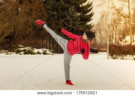 Woman Wearing Sportswear Training Boxing Outside