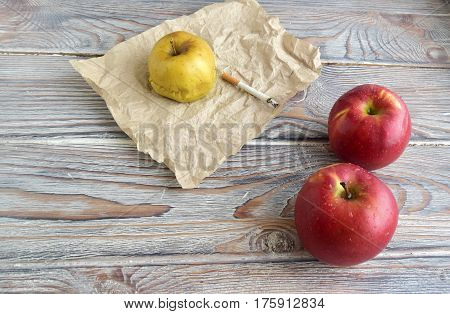 Red apples symbolize a healthy organism. Green apple symbolizes harm from smoking.