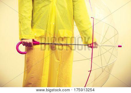 Woman Wearing Waterproof Coat Holding Umbrella