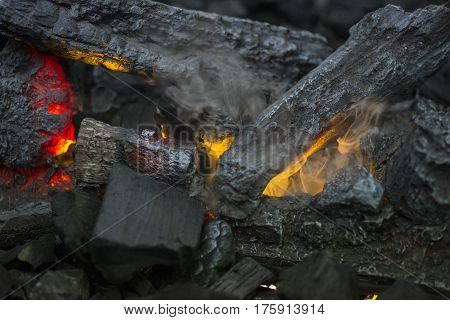 Close up of flames in log fire in cozy warm fireplace