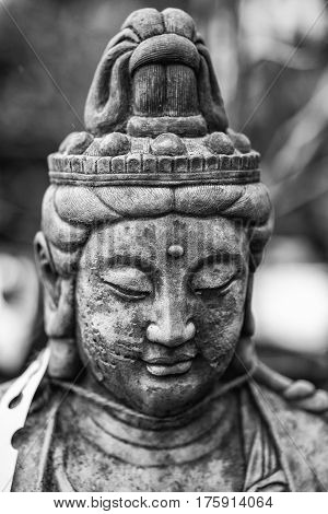 Beautiful Buddha Statue Portrait With Shallow Depth Of Field For Drawing Attention To The Face