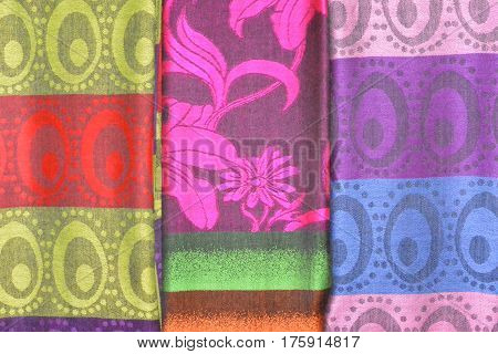 Abstract woven multi-color fabrics using traditional designs.  Woven cloths with colorful patterns and textures are popular tourist souvenirs in Vietnam and throughout Asia.  Close up.  Horizontal image.  Photography.