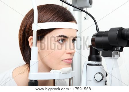 woman doing eyesight measurement with optical slit lamp