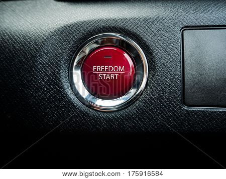 Big red freedom button on the black background