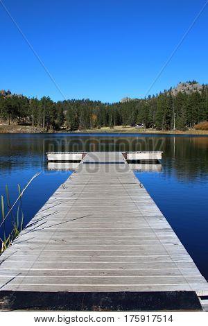 Dock headed towards a tranquil lake in South Dakota