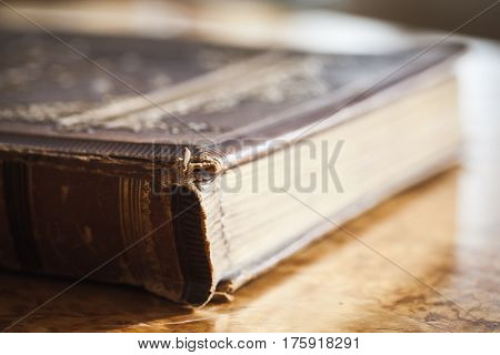 Closed Vintage Book Lays On Wooden Table