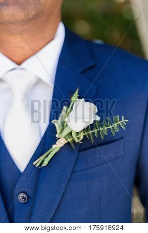 A Groom wearing a blue suit background