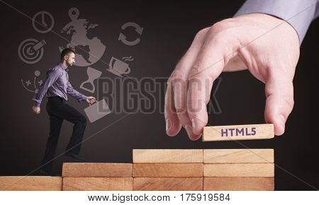 Business, Technology, Internet And Network Concept. Young Businessman Shows The Word: Html5