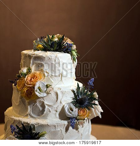 Three store Wedding cake with flowers decoration
