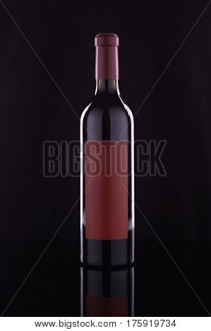 Wine bottle with red lable on black