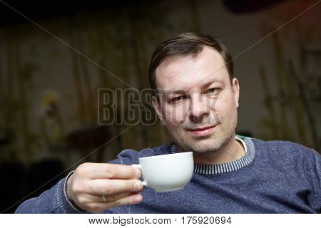Portrait of man with cup of tea