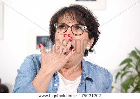 a portrait beautiful mature woman tired and yawning