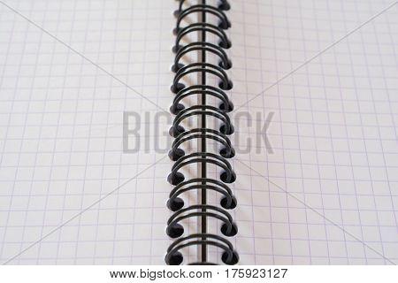 Closeup of spiral metal binding notebook. Shallow depth of field.
