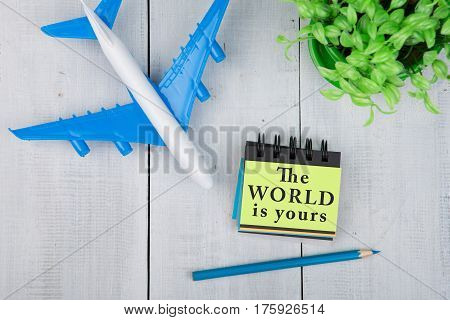 Plane And Note Pad With Text