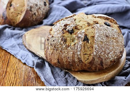 Irish soda bread in a rustic setting on an old wood table top.