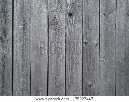 infinitely long and high wall of old boards