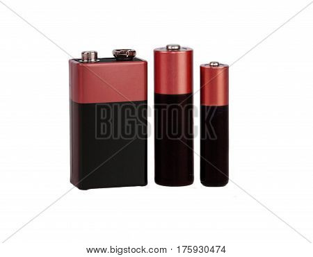 Different batteries, type AAA, type AA, type PP3, white background, isolated