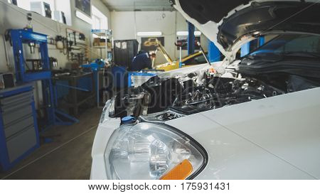 Car preparing for repairing - garage mechanical workshop, small business, wide angle