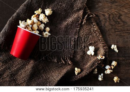 Popcorn on dark background with copyspace cinema movies and entertainment concept
