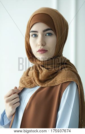 Studio photo of a beautiful young woman dressed oriental type in the Muslim style Russia