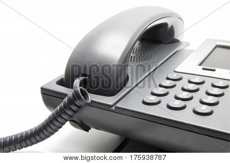 IP Phone on white background (Keypad and receiver close-up)