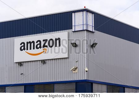 Dobroviz, Czech Republic - March 12: Amazon Electronic Commerce Company Logo On Logistics Building O