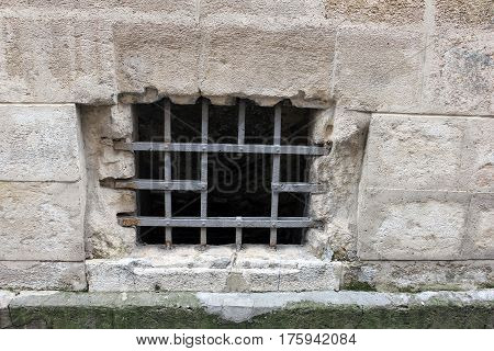 small Dungeon window and gray brick wall